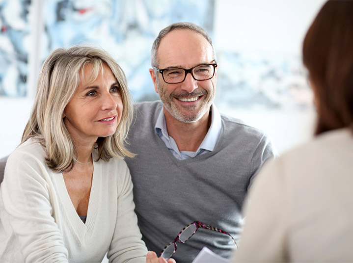 couple talking to bankruptcy attorney